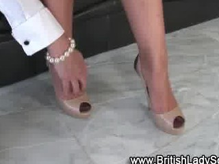 grownup brit femdom shoe posing for the camera