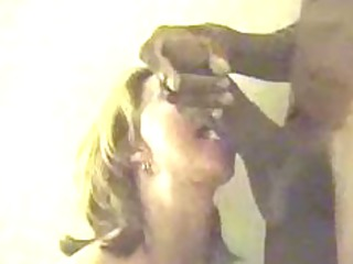 mature woman deepthroats massive dark cock