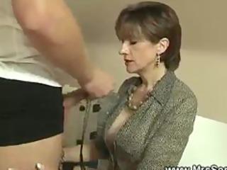 dominatrix licks her slaves cock off