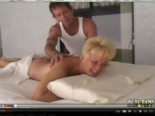 young mother pierced on massage stall