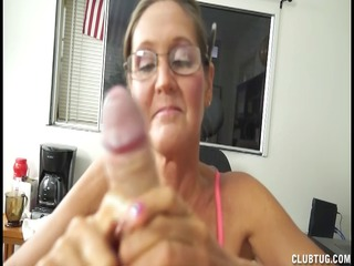 a busty mature babe licks and jerks