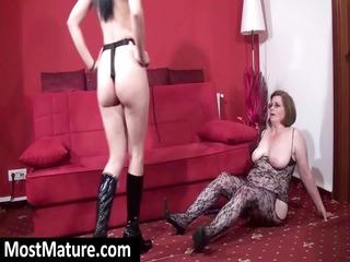 grownup woman in figure  lingerie licks strapon