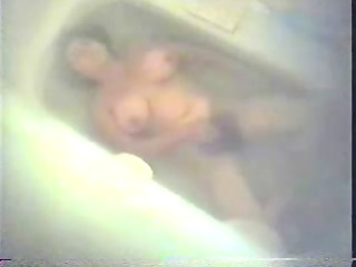 furry woman pushing dildo inside tub tube.