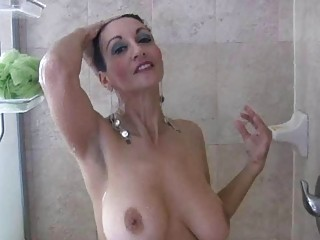 brunette mature babe with big boobs pleases under