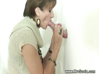 cuckold sees desperate lady licking gloryhole