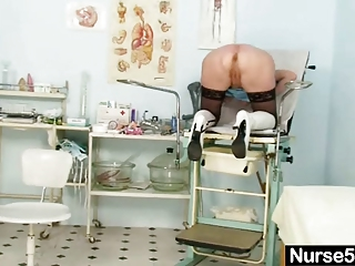 albino elderly doctor self exam with cave spreader