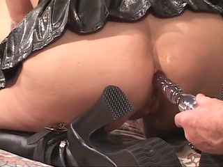 slave obtains bound to bed with leather cuffs on
