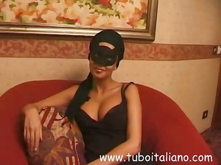 brunette italian lady into a mask gets a filled