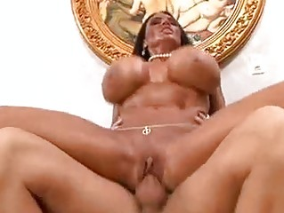 tanned brunette momma with gigantic knockers